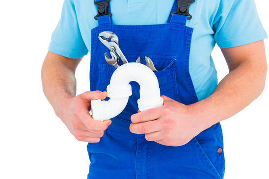 Cropped image of male plumber holding sink pipe on white background